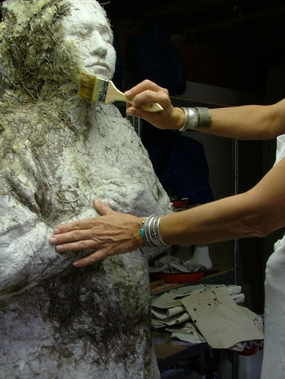 Applying encaustics to one of the Mothers